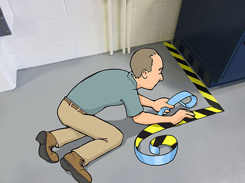 applying hazard floor tape
